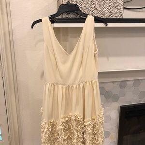 Minuet elegant cream ruffle bottom dress